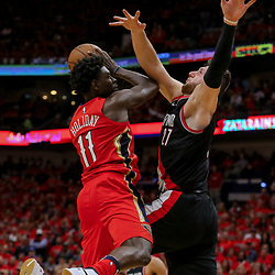 Apr 21, 2018; New Orleans, LA, USA; New Orleans Pelicans guard Jrue Holiday (11) draws a foul shooting against Portland Trail Blazers center Jusuf Nurkic (27) during the fourth quarter in game four of the first round of the 2018 NBA Playoffs at the Smoothie King Center.  Pelicans defeated the Trail Blazers 131-123 sweeping the series and advancing to the western conference semi-finals.  Mandatory Credit: Derick E. Hingle-USA TODAY Sports