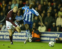 Photo: Aidan Ellis.<br /> Wigan Athletic v Arsenal. Carling Cup. Semi Final, 1st Leg.<br /> 10/01/2006.<br /> Wigan's Jason Roberts battles with Arsenal's Phillipe Senderos