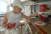Passenger feeding Parrot aboard Star Flyer.
