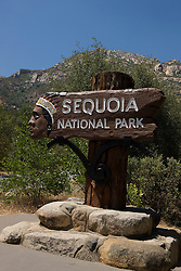 A National Park Service welcome sign to Sequoia National Park, located near the Ash Mountain Entrance along the Generals Highway, California, USA