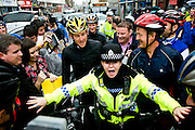 Lance Armstrong cycled in Paisley with around 70 other cyclists after announcing the ride on Twitter.<br /> <br /> A police woman holds back fans as they try to get books signed and meet their hero, while Lance stands looking bemused.<br /> <br /> &copy; John Linton<br /> All rights reserved