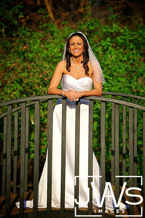 White wedding dress upon a bridge in the Grapevine Arboretum