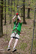 Chuck Fries, Park Manager at Bristol Mountain's new Aerial Adventure Park, descends a zipline on Tuesday, May 20, 2014.