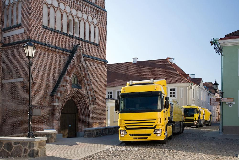 Row of Fuel Company Gasoline Trucks on narrow street in Tartu, Estonia
