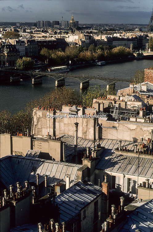 France. Paris. Elevated view on the Seine river. Bridge over Seine, The seine river  , Sainte clotilde church bell tower,  the roofs . .  Paris  France   Paris