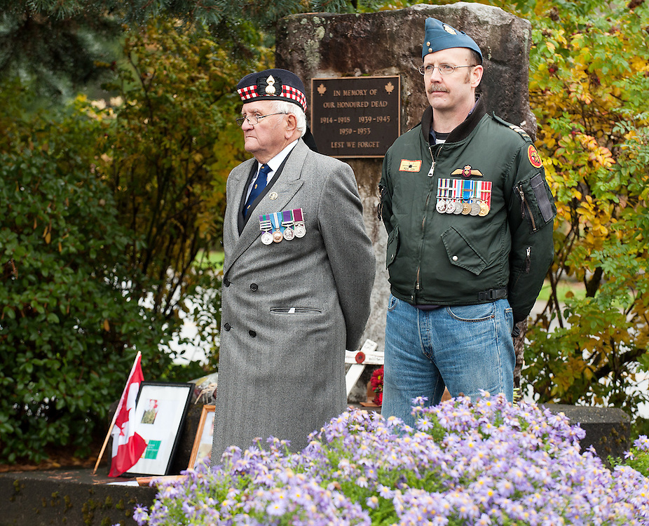 (L-R) Retired soldiers Warrant Officer Colin MacConnachie from the British Army's Royal Highland Fusiliers and Captain Rob Cox of the RCAF, stand guard at the Whistler Cenotaph.  Saturday, October 25th, 2014.<br /> <br /> Photo Credit: David Buzzard