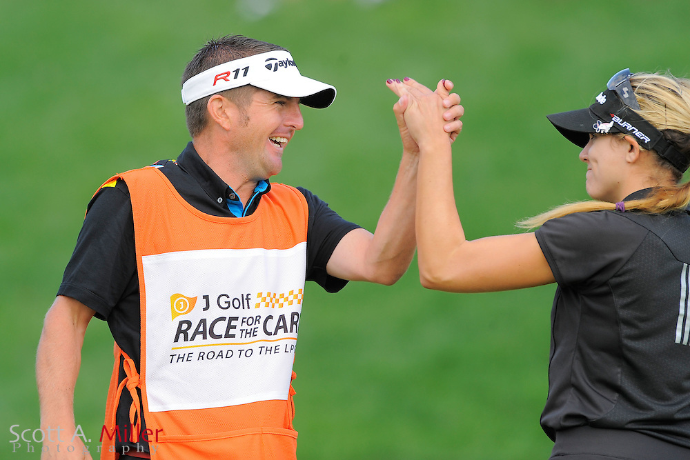 Sydnee Michaels and her caddie Lorcan Morris celebrate winning the LPGA Future Tour's Price Chopper Tour Championship at Capital Hills at Albany on Sept. 11, 2011 in Albany, N.Y...©2011 Scott A. Miller