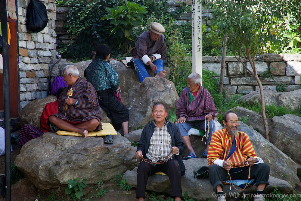 Asia, Bhutan, Thimpu. Bhutanese Buddhists at Memorial Chorten.