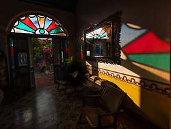"""We love staying in """"Casa Particulares,"""" lovely B&Bs in the homes of enterprising and welcoming Cubans.  Our casa in Remedios is aptly named """"Las Vitrales"""" which refers to the semicircle of stained glass above the doors in colonial homes."""