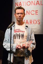 © Licensed to London News Pictures. 26/01/2015. London, England. Mark Bruce of the Mark Bruce Company receives the award for the best independent company. The Critic's Circle National Dance Awards 2014 take place at The Place in London, UK. Photo credit: Bettina Strenske/LNP