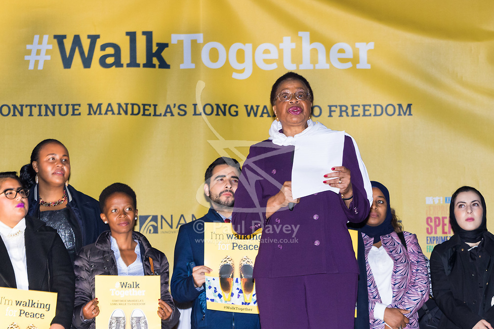 "London, October 23 2017. Nelson Mandela's group of Elders including former UN Secretary General Kofi Annan and Secretary General Ban Ki-moon accompanied by his widow Graca Machel gather at Parliament Square at the start of the Walk Together event in memory of Nelson Mandela before a candlelight vigil at his statue in Parliament Square. ""WalkTogether is a global campaign to inspire hope and compassion, celebrating communities working for the freedoms that unite us"". PICTURED: Mandela's widow Graca Machel addresses the crowd in Trafalgar Square. © Paul Davey"