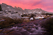Sunset and stream at the Four Gables Peak just below Upper French Lake during a backpacking trip in the High Sierra mountains outside of Bishop, CA, July, 2016.