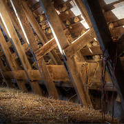 Hay in a barnloft during an early morning sunrise on a rural missouri farm.