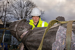 The sculpture of Sherlock Holmes by former pop-artist Gerald Laing is being moved from it's home on Picardy Place, yards from the birth place of Sir Arthur Conan Doyle.<br /> <br /> The move of the sculpture is to accommodate road and tram works that are taking place in Edinburgh. The statue will be moved to Nairn at  Black Isle Bronze Ltd by the artists son, Farquhar Laing where it will stay for two years until it returns to Edinburgh.<br /> <br /> Pictured: Sculptor's son, Farquhar Laing checks the Sherlock Holmes sculpture before it starts its journey to Nairn