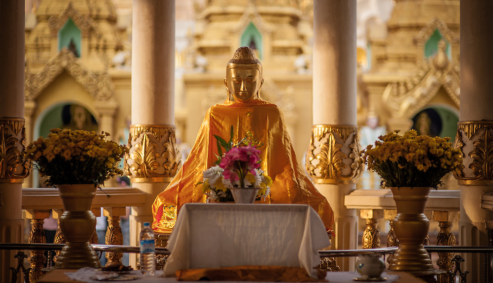 Golden Buddha in Shwedagon pagoda in Yangon (Myanmar)