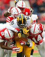 Iowa Hawkeyes tight end Henry Krieger Coble (80) drags defenders with him after a catch during the second quarter of their NCAA football game at Memorial Stadium in Lincoln, Neb. on Friday, Nov. 27, 2015. Iowa defeated Nebraska 28-20.