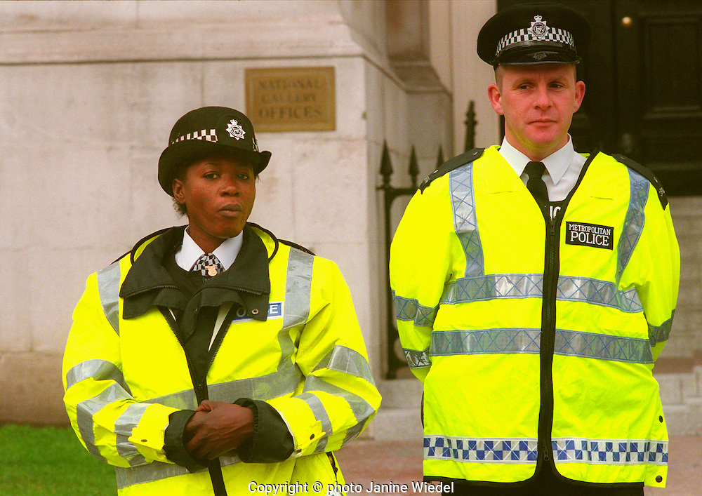 Policeman and policewoman on the beat together in London.