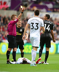 Isaac Hayden of Newcastle United is shown a yellow card after a tackle on Renato Sanches of Swansea City - Mandatory by-line: Alex James/JMP - 10/09/2017 - FOOTBALL - Liberty Stadium - Swansea, England - Swansea City v Newcastle United - Premier League