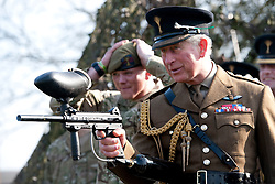 © Licensed to London News Pictures. 01/03/2012. Hounslow, UK.  HRH  Prince Charles, The Prince of Wales firing a paintball gun with The Prince of Wales Guards after Presenting leeks to 1st Battalion The Welsh Guards at Cavalry Barracks,  Hounslow, London on St David's Day, March 1st, 2012.  Two-thirds of the Battalion's 600 soldiers are due to be deployed to Afghanistan in the next two weeks. Photo credit : Ben Cawthra/LNP