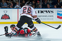 KELOWNA, CANADA - OCTOBER 13: Andrew Fyten #26 of the Calgary Hitmen checks Nolan Foote #29 of the Kelowna Rockets to the ice during first period on October 13, 2017 at Prospera Place in Kelowna, British Columbia, Canada.  (Photo by Marissa Baecker/Shoot the Breeze)  *** Local Caption ***