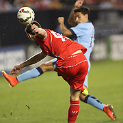 Jack Robinson, Liverpool, clears during the Manchester City Vs Liverpool FC Guinness International Champions Cup match at Yankee Stadium, The Bronx, New York, USA. 30th July 2014. Photo Tim Clayton