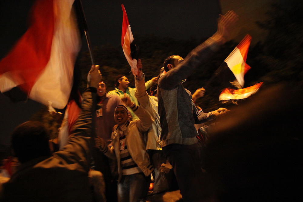 Pro-democracy protesters celebrate near Tahrir Square minutes after Vice President Omar Suleiman announced live on TV that Hosni Mubarak had resigned as president of Egypt.