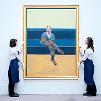 London, UK - 12 April 2013: Sotheby's employees pose in front of Francis Bacon's greatest painting of the love of his life, Peter Lacy (Est. $30-40 million). The work will go on sale at Sotheby's New York in May 2013. The Blockbuster sales at include works by Richter, Modigliani, Picasso, Rodin, Bacon, Cezanne.