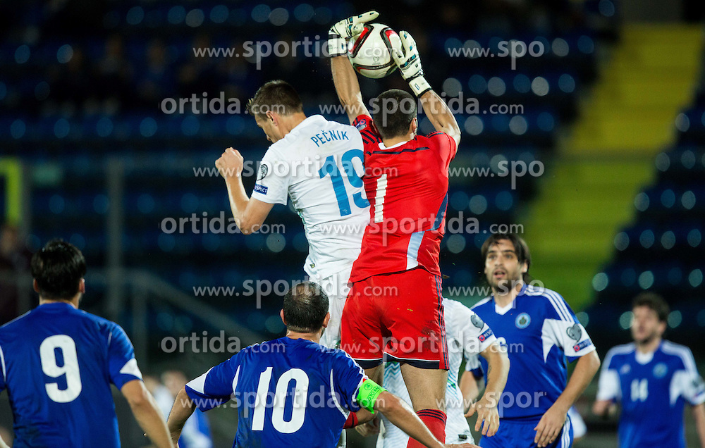 Nejc Pecnik of Slovenia vs Aldo Simoncini of San Marino during football match between National teams of San Marino and Slovenia in Group E of EURO 2016 Qualifications, on October 12, 2015 in Stadio Olimpico Serravalle, Republic of San Marino. Photo by Vid Ponikvar / Sportida