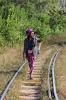 KALAW, MYANMAR - DECEMBER 06, 2016 : woman local tribe walking on a railroad track near Kalaw Shan state in Myanmar (Burma)