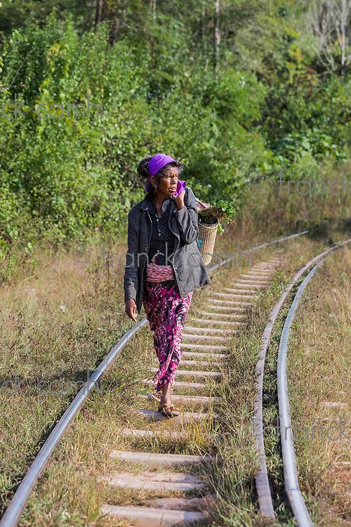 KALAW, MYANMAR - DECEMBER 06, 2016 : woman local tribe walking on a railroad track near Kalaw Shan state in Myanmar (Burma)