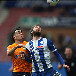 Kean Bryan of Oldham Athletic (L) and Nick Powell of Wigan Athletic in action - Mandatory by-line: Jack Phillips/JMP - 30/03/2018 - FOOTBALL - DW Stadium - Wigan, England - Wigan Athletic v Oldham Athletic - Football League One