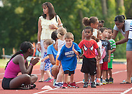 Middletown, New York - Children line up to compete in the long jump during the Twilight Track and Field Series run by the Middletown High School Varsity track program on July 22, 2014.