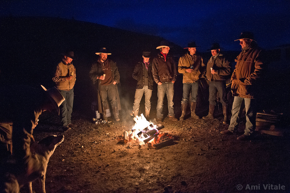 Cowboys gather around a fire after a snowstorm and long day of herding cattle in the Centennial Valley of Southwestern Montana, June 13, 2012. Ranching is tough business with most working 14-16 hour days in the calving season  in the Centennial Valley of Southwestern Montana, June 13, 2012. Spurred by growing consumer concern over meat's environmental impact and concerned about the long-term viability of their livelihood, a cohort of ranchers is trying to apply the understanding gleaned from the science of ecology to livestock management.
