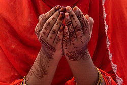 June 26, 2017 - Kolkata, India - A Muslim girl in deep prayers with hands painted with henna tattoos during the Eid prayers Of Eid al-fitr in Kolkata (Calcutta). (Credit Image: © Sushavan Nandy/NurPhoto via ZUMA Press)