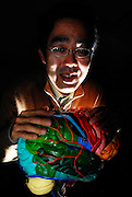 Neuroscientist Dr. Ryuta Kawashima, the brains behind Nintendo's DS brain training games, poses with a model brain at his office in Sendai, Japan.