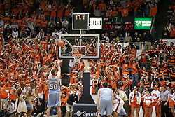 The Hoo Crew, aka 6th Man, distract UNC's Tyler Hansbrough (50) shooting a free throw late in the second half.  UVA beat the Tarheels 72-68.