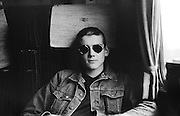 Rod Hood sitting in the train with sunglasses, High Wycombe, UK, 1980s.