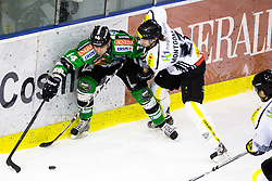 3.01.2014, Hala Tivoli, Ljubljana, SLO, EBEL, HDD Telemach Olimpija Ljubljana vs Dornbirner Eishockey Club, 63rd Game Day, in picture Matej Hocevar (HDD Telemach Olimpija, #14) vs Kevin Montgomery (Dornbirner Eishockey Club, #27) during the Erste Bank Icehockey League 63rd Game Day match between HDD Telemach Olimpija Ljubljana and Dornbirner Eishockey Club at the Hala Tivoli, Ljubljana, Slovenia on 2014/01/03. (Photo By Matic Klansek Velej / Sportida)