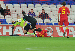Joe Allen of Wales makes a vital save after a shot on goal from Shane Long of Republic of Ireland   - Photo mandatory by-line: Alex James/JMP - Tel: Mobile: 07966 386802 14/08/2013 - SPORT - FOOTBALL - Cardiff City Stadium - Cardiff -  Wales V Republic of Ireland - International Friendly