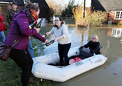 Boxing Day floods..A resident in Yalding, Kent, removing bottles of wine from her  home as she prepares for more flooding with another storm on the way, Thursday, 26th December 2013. Picture by Stephen Lock / i-Images