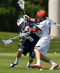 Virginia Cavaliers M/A John Haldy (12) stops Villanova Wildcats Midfield Tommy Nolan (3) from getting a loose ball.  The #5 ranked Virginia Cavaliers defeated the #19 ranked Villanova Wildcats 18-6 in the first round of the 2008 NCAA Men's Lacrosse Tournament the University of Virginia's Klockner Stadium in Charlottesville, VA on May 10, 2009.