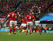 Wales Dan Biggar scoring a drop goal just before half time to put Wales in fron 13 - 12 during the Rugby World Cup Quarter Final match between South Africa and Wales at Twickenham, Richmond, United Kingdom on 17 October 2015. Photo by Matthew Redman.