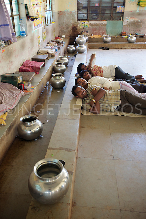 Hair cutters resting while waiting for customers, mornings are very busy, late afternoon is good for a nap.<br />