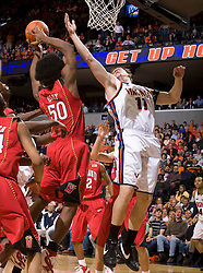 Maryland forward Bambale Osby (50) grabs a rebound from Virginia forward Laurynas Mikalauskas (11) as Virginia guard Sean Singletary (44) is knocked to the floor.  The Virginia Cavaliers defeated the Maryland Terrapins 91-76 at the University of Virginia's John Paul Jones Arena  in Charlottesville, VA on March 9, 2008.