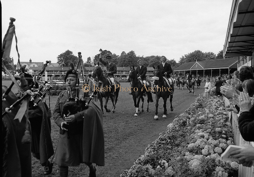 Aga Khan Trophy..1979..10.08.1979..08.10.1979..10th August 1979..The annual staging of the Aga Khan Cup took place  at the Royal Dublin Showgrounds, Ballsbridge,Dublin today.It was the first time since 1937 that Ireland won the trophy outright. The winning Irish team comprised of Paul Darragh,Capt Con Power,James Kernan and Eddie Macken..Image of the victorious Capt Con Power, James Kernan and Eddie Macken on a lap of honour after winning the Aga Khan cup. Note Capt Con Power waving the trophy in the air.