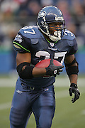 SEATTLE - NOVEMBER 28:  Running back Shaun Alexander #37 of the Seattle Seahawks rushed for 39 yards on 13 carries against the Buffalo Bills at Qwest Field on November 28, 2004 in Seattle, Washington. The Bills defeated the Seahawks 38-9. ©Paul Anthony Spinelli *** Local Caption *** Shaun Alexander