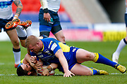 Featherstone Rovers scrum half Tom Holmes (19) is tackled during the Challenge Cup 2018 match between Doncaster and Featherstone Rovers at the Keepmoat Stadium, Doncaster, England on 22 April 2018. Picture by Simon Davies.