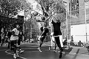 "April 24th 2008. New York, New York. United States..Located in the heart of Greenwich Village, the West 4th Street basketball Court, known as ""The Cage"", offers no seating but attracts the best players and a lot of spectators as soon as spring is around the corner..Half the size of a regular basketball court, it creates a fast, high level of play. The more people watch, the more intense the games get. « The Cage » is a free show. Amazing actions, insults and fights sometimes, create tensions among and inside the teams. The strongest impose their rules. Charisma is present..""The Cage"" is a microcosm. It's a meeting point for the African American street culture of New York. Often originally from Jamaica or other islands of the Caribbean, they hang out, talk, joke, laugh, comment the game, smoke… Whether they play or not, they're here, inside ""The Cage"". Everybody knows everybody, they all greet each other, they shake hands and hug: ""Yo, whasup man?"""