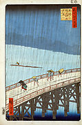 Sudden Shower over Oshashi Bridge and Atake ', 1857. Utagawa Hiroshige (1797-1858) Japanese Ukiyo-e artist  'One Hundred Famous View of Edo' (Tokyo). Pedestrians caught in heavy rain on wooden bridge. Civil Engineering Weather