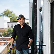 May 12, 2017 - New York, NY : Syed Ali poses for a portrait on the fire escape of his apartment in Bay Ridge, Brooklyn on Friday afternoon, May 12. Syed, who is a combat veteran with the United States Army and an officer with the New York Police Department, was detained at John F. Kenney Airport earlier this year when he returned from vacation overseas after his most recent deployment -- this despite having his Military ID and US Passport.  CREDIT: Karsten Moran for The New York Times